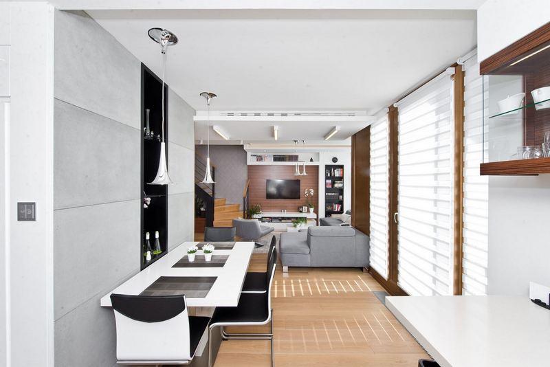 nowoczesna otwarta kuchnia z prostokatnym stolem