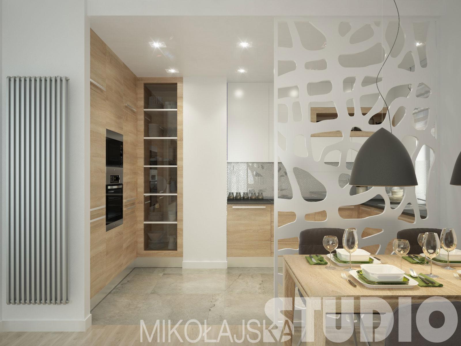 nowoczesna kuchnia w bieli i drewnie z salonem