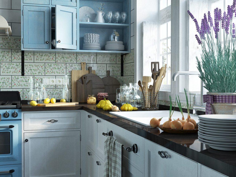 mala kuchnia z niebieskimi frontami szafek